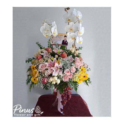 bunga meja Surabaya - Blooming Orchid in Vase